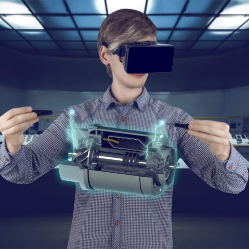 Virtual reality in engineering concept. Male / man engineer wearing shirt and vr glasses fixing holographic engine for mechanic industry with screwdrives on futuristic plant background with control panels.